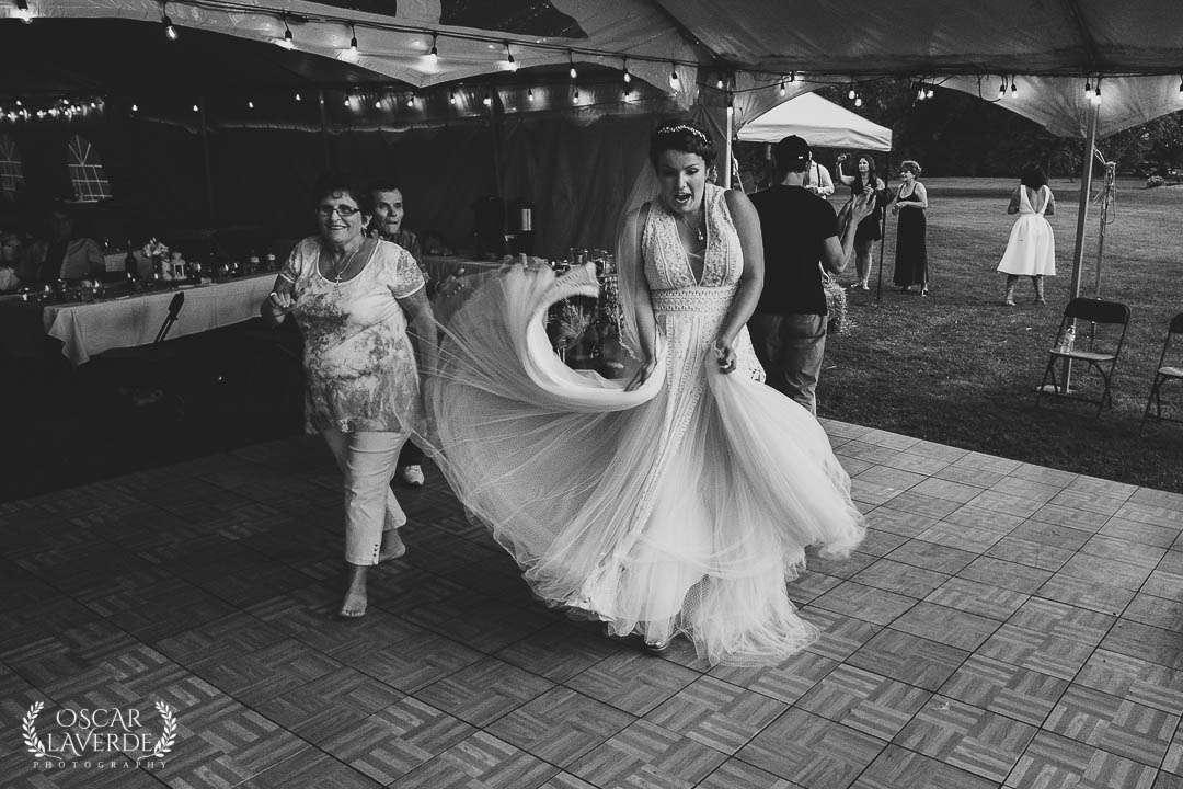 Candid wedding photo of bride dancing