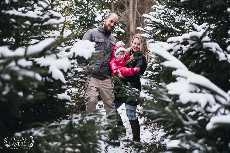 Family cutting Christmas tree at tree farm