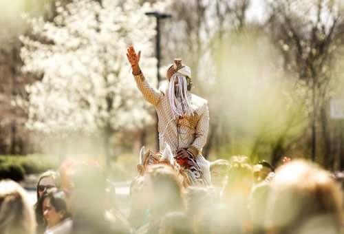 Indian groom riding baraat horse - London, Ontario