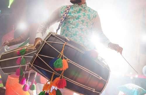 Dhol player during sangeet mehndi party